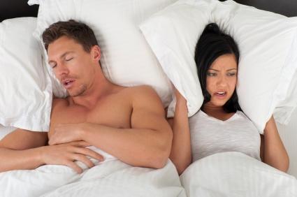 Woman being kept awake by her husbands snoring